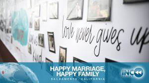 photos of families on wall with text love never gives up